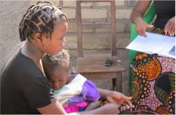 Image of mother in Zambia with young child