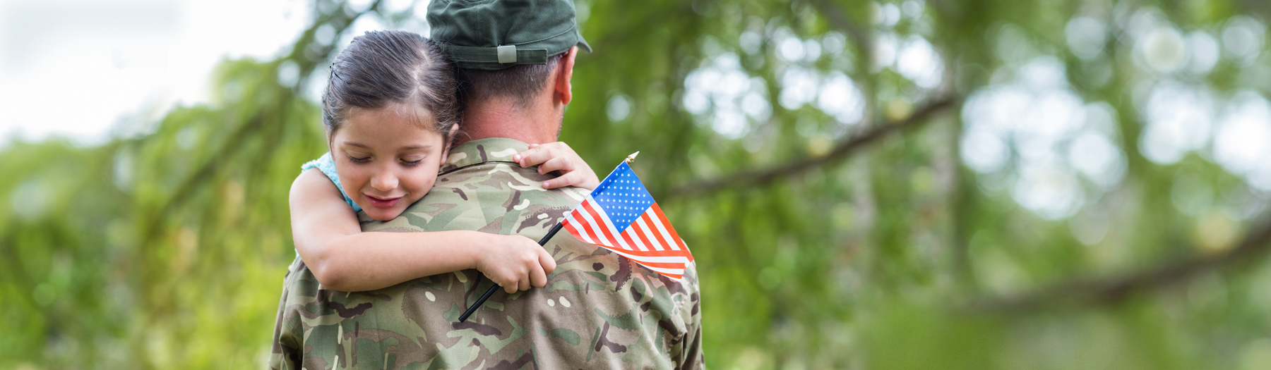 Image soldier embracing his daughter
