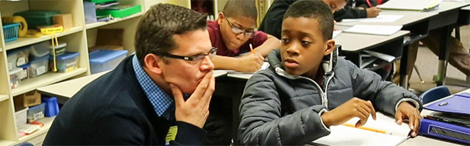 AIR math instruction expert ponders a difficult question with a young student