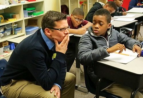 Kirk Walters helps a student wrangle a thorny math problem