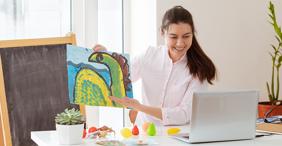 Image of teacher showing art to an online audience