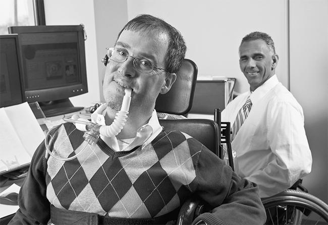 Man with disabilities with co-worker