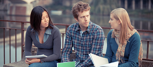 Image of young adults talking on campus