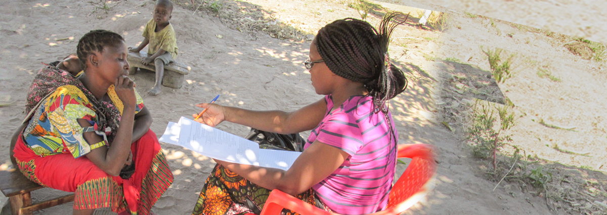 Image of two young women reading outside in Zambia